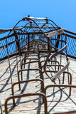 Iron ladder. Old rusty iron ladder on chimney inside view Stock Photography