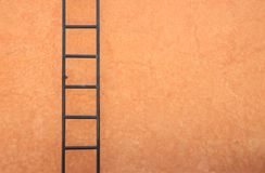 Iron ladder on the wall. Royalty Free Stock Images