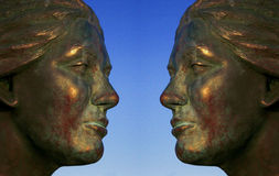 Iron Lady Mirrow. A digital image of an iron ladys face with a blue sky background royalty free illustration