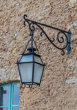Iron lantern against the stone wall Stock Photography