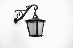 Iron lantern on wall Royalty Free Stock Images