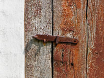 Iron latch on a wooden door Royalty Free Stock Photos