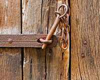 The iron latch on wooden door Royalty Free Stock Images