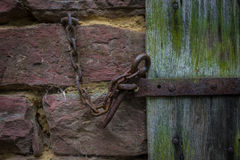 The iron latch on a wooden door Royalty Free Stock Photography