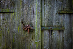 The iron latch on a wooden door Royalty Free Stock Image