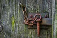 The iron latch on a wooden door Stock Photo