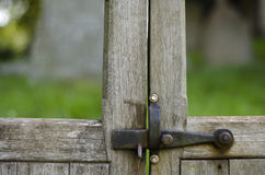 Iron latch on wooden handcrafted gate. Royalty Free Stock Photos
