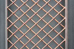 The iron lattice. Textural background. Close-up Stock Images