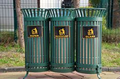 Iron lattice trash bins for sorting garbage - plastic, paper and glass. Iron lattice trash bins for sorting garbage into plastic, paper and glass Stock Photos