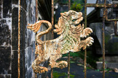 Iron lion rusty detail on the gate of a Balinese temple. Pura Lempuyang Luhur Indonesia Stock Photo
