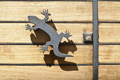 Iron lizard handle and shadow Royalty Free Stock Photos