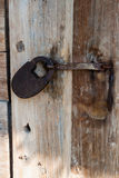 Iron lock on an old wooden door Stock Photos
