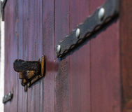 Iron lock on a wooden blind Stock Images