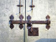 Iron Locking Bar on Old Rome Building Stock Photo