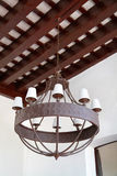 Iron luster colonial style on a ceiling Royalty Free Stock Photo