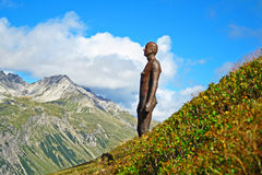 Iron man alps. Iron man statue in the tyrolean alps near st.anton am arlberg in tyrol austria Royalty Free Stock Photo