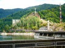 Iron man. Watches over dam in Romania Royalty Free Stock Photos