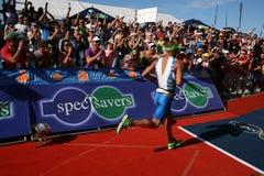 Iron man winner. The winner of iron man south africa 2011, Raynard Tissink running to the finish line Stock Image