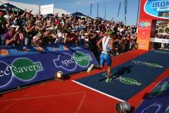 Iron man winner. The winner of iron man south africa 2011, Raynard Tissink running to the finish line Royalty Free Stock Photography