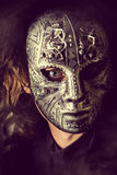 Iron mask. Portrait of a mysterious man in iron mask. Steampunk. Fantasy. Halloween Royalty Free Stock Photography