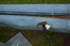 Iron metal tin rusty old industrial pipe with tap drain valve with valve.  stock photo
