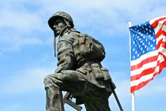 Iron Mike, Sainte-Mere-Eglise, Normandy, France. Bronze statue of an Iron Mike, a soldier of the American Army holding a gun with a flag of the United States of Royalty Free Stock Photography