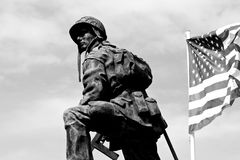 Iron Mike, Sainte-Mere-Eglise, Normandy, France. Bronze statue of an Iron Mike, a soldier of the American Army holding a gun with a flag of the United States of Stock Image