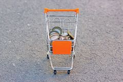 Iron money in a grocery cart in the open area, the view from the top stock photos