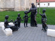 Iron Monk Statue with kids Stock Image