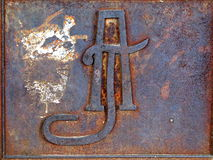 Iron monogram. Monogram on an iron gate in the historical centre stock photos
