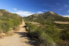 Iron Mountain Hiking Trail in Poway, San Diego County North Inland, California USA. Iron Mountain Hiking Trail near Parking area on junction of Poway Road and Stock Photos