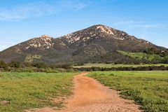Iron Mountain, Southernmost Peak in Poway, California. Iron Mountain, the southernmost peak in a small mountain complex dividing the city of Poway from the semi Stock Photos