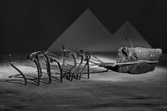 Iron nail slaves pull brick on rope concept abstract artistic co Stock Photo