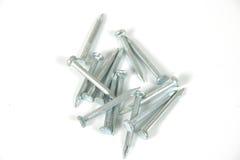 Iron nails. On white Stock Photos
