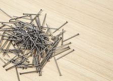 iron nails on a wooden Stock Image