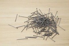 Iron nails on a wooden Royalty Free Stock Images