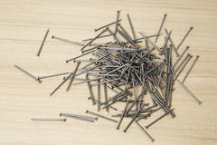 Iron nails on a wooden Royalty Free Stock Photo