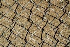 Iron net with shadow Stock Photos