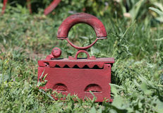 Iron. Old-fashioned iron in the grass Stock Image