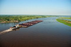 Paraguay River. Iron ore boat sailing on the Paraguay River in the region of Corumba, Mato Grosso do Sul, Brazil royalty free stock photography