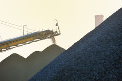 Iron ore and conveyor Royalty Free Stock Photo