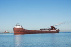 Iron Ore Delivery. A Great Lakes self discharging bulk carrier laden with iron ore taconite waits for clearance to proceed to a bulk terminal inside the stock images