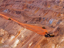 Iron ore extraction in quarry Stock Photos