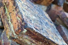 Iron ore mineral rich cut ornamental stone. With cracks stock image