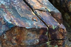 Iron ore mineral rich cut ornamental stone with cracks.  stock image