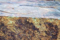 Iron ore mineral rich cut ornamental stone. With cracks stock images