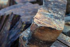 Iron ore mineral rich cut ornamental stone. With cracks royalty free stock images