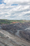 Iron ore mining. View to the iron ore mining with industrial landscape Stock Photos