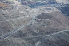 Iron ore mining. View to the iron ore mining with roads and machinery Royalty Free Stock Photo