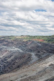 Iron ore mining. View to the iron ore mining with roads and railway Royalty Free Stock Photos